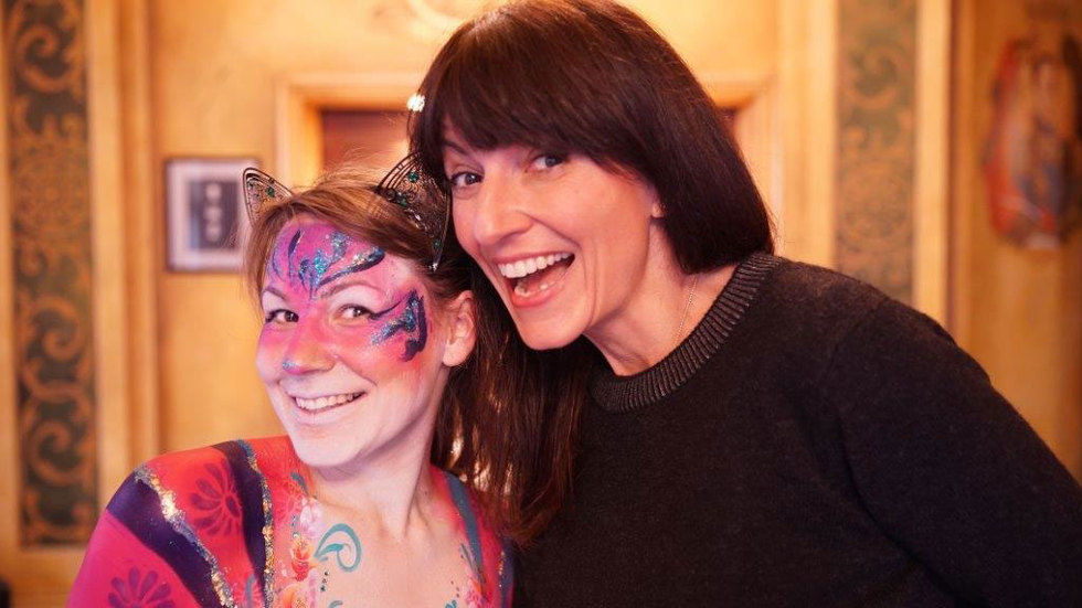 Davina McCall with a young girl.