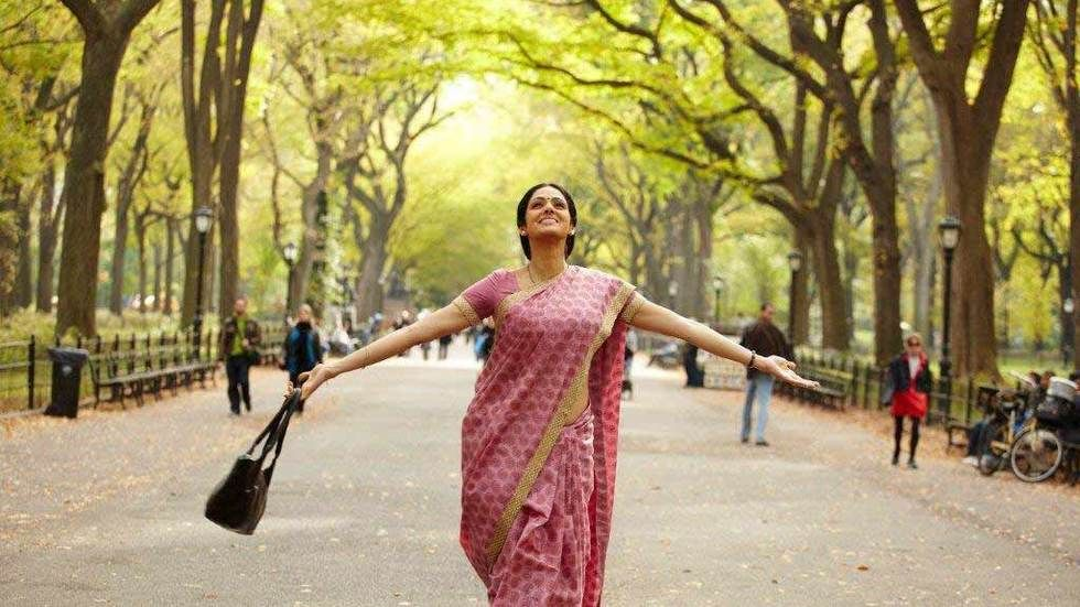 Sridevi with arms outstretch under trees.