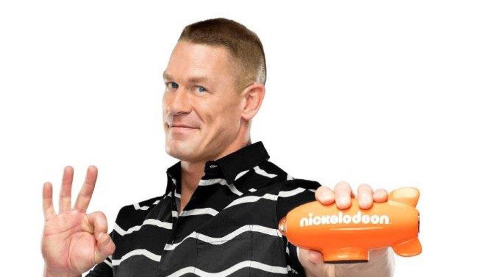 John Cena holds a Nickelodeon plane