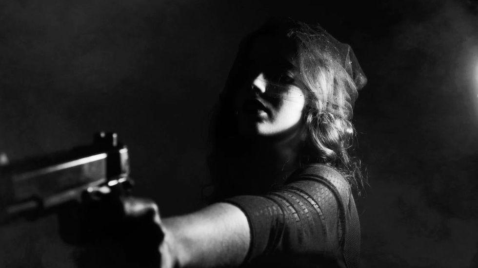 woman holds a gun