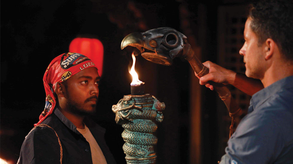 Ace watches as his torch is extinguished on the fourth episode of Survivor South Africa: Philippines.