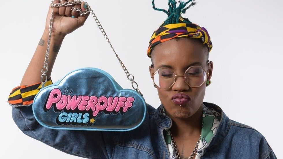 Toya Delazy holds up a Powerpuff Girls sign