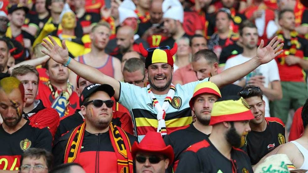 Fans from Belgium celebrate.