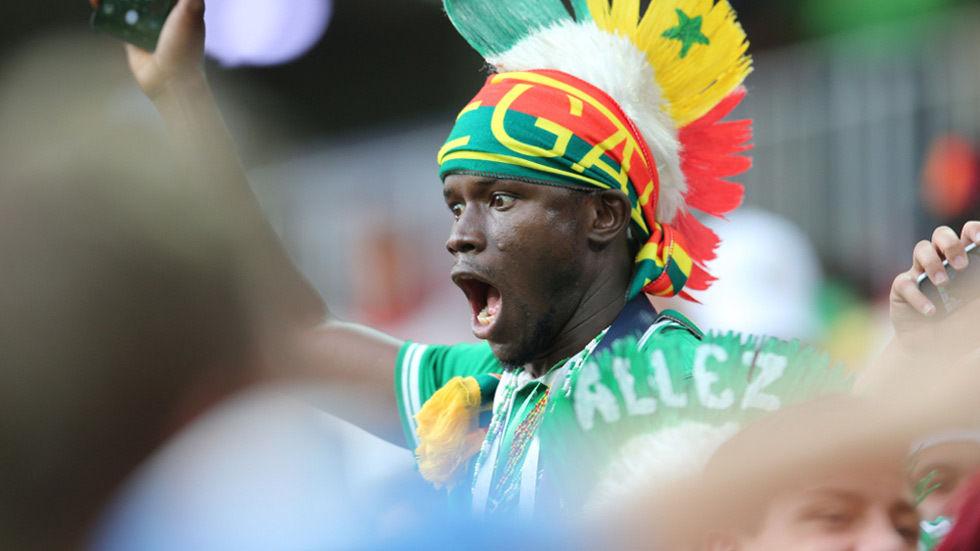 A fan from Senegal celebrates.