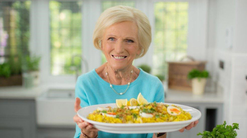 Mary Berry holding a dish
