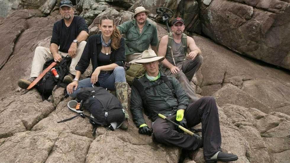 Team of explorers on the rocks