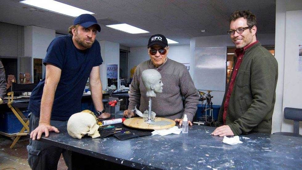 team of UFO Hunters with a skull