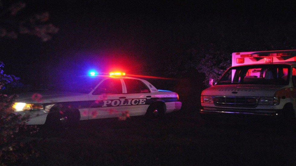 police cars at night with lights on